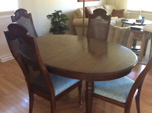 Solid Dining room table and Four cane back chairs $145.00