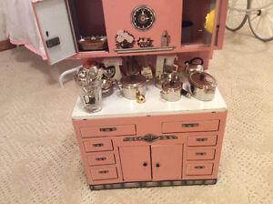 Pink toy kitchen cupboard