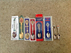 8 each Collector Spoons