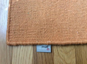 Unique woven wool area rug with loops