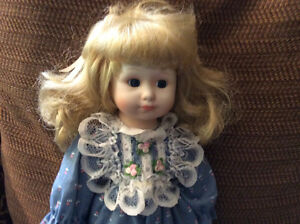 Porcelain Doll-  Little Girl with printed Blue Dress and Lace