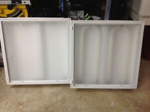 2 Fluorescent light fixtures 2'x 2' used for sale.