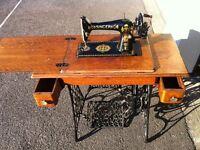 Vintage treadle Singer sewing machine, cast iron