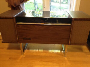 Vintage stereo system with turn table.
