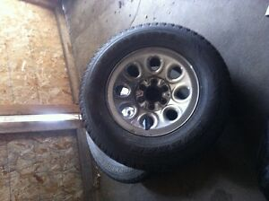 A pair of stock 17 inch GM 6 bolt rims