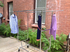 Two Rolling Clothes Racks