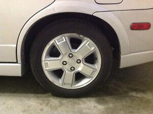 """4 rims, 15"""" - 4 bolt pattern, excellent condition."""
