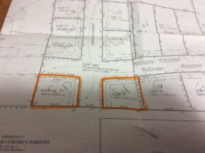 2 Approved  sewer serviced building lots in a subdivision