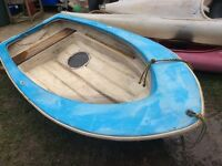 Small rowing boat dingy. Not canoe Kayak.