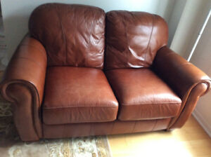 Brown Leather 2 Seater and Chair 1/2 and foot stool, $2,000.