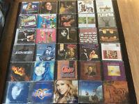 Lot de cds usages mais en parfait etat sans aucune rayures 2$ ch