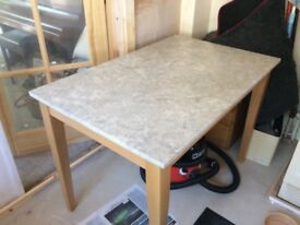 Marble topped table seats 4-6