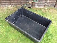 Large rigid vat suitable for making a garden pond