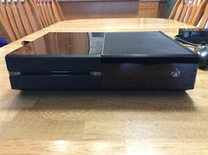 Xbox One with two controllers and three games