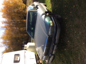 1993 Buick Park Avenue Sedan and two free brand new watches