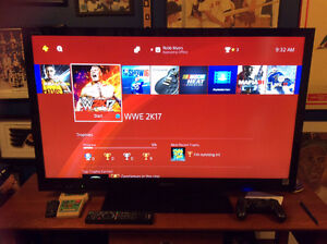 500 GB PS4 with multiple games including NHL17, WWE2K17