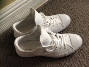 Converse- all white leather shoes.