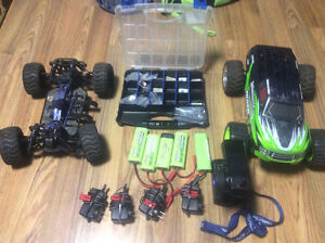 2 - 1/10 Scale 4WD Trucks, Lots of parts & Batteries