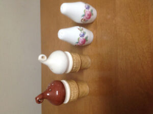 Two sets of Salt and Pepper Shakers