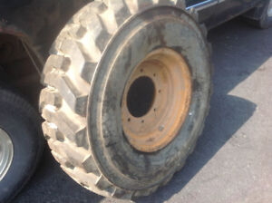RIM AND TIRES 12.5 /80-18  OF CASE 580SJ TIRE IS BRAND NEW