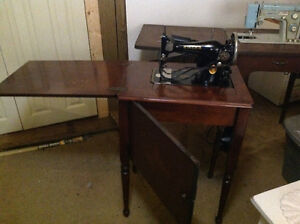 2 vintage sewing machines built in cabinets