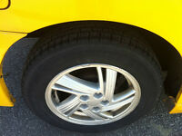 """A set of 14"""" Stock Aluminum Rims and Tire from Pontiac Sunfire"""