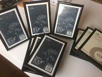 "Nine 6x4"" black Photo frames"