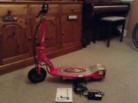 Razor E100 electric scooter in pink offers considered