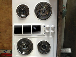 White Jenn air counter top stove with fan