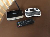 Android box with keyboard remote.