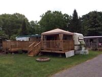 Family trailer in park with boat very good condition