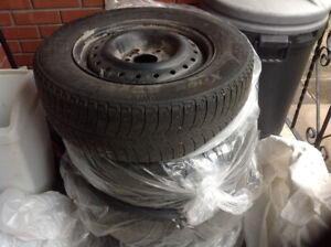 4 USED MICHELIN X ICE WINTER TIRES 205/65R/15 WITH RIMS