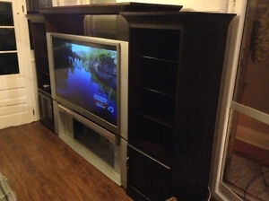 """62"""" Toshiba DLP HDTV with stand and entertainment unit"""