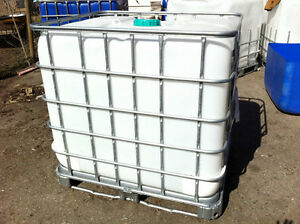 1000 litre food grade totes in galvanized cage, like new