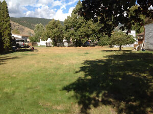 Merritt- Large Flat Lot With Lane Access Ready for a Home!