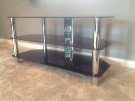 TV table in as new condition, black glass and chrome.