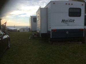33 ft Hornet trailer with 20by 10 sunroom