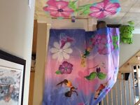 Disney fairies shower curtain and area rugs.