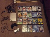 Sony PlayStation 2 console and 19 games with 2 controllers
