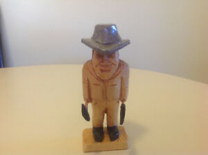 Hand carved prospector