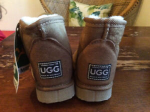 UGG boots. New with tags. Size 5t.