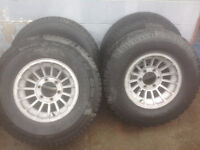 SET OF FOUR RIMS   905-351-0470