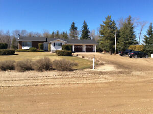 Beautiful Acreage located in RM of Roblin, MB