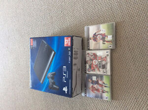PS3 with 2 controllers and 2 games