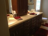 Ensuite double vanity,solid surface counter, faucets, lights