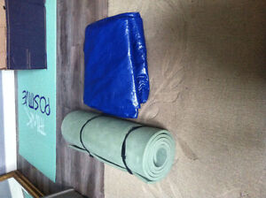Tarps and roll out camping mat