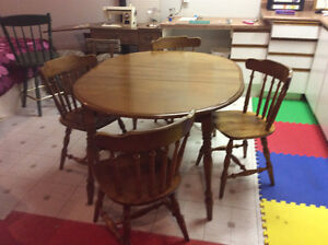 Round solid maple diningroom table and four chairs $95.00