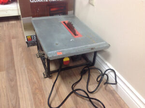 Used bench saw...taxes in.