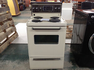 "Used GE 24"" Apartment size stove..beige, good condition."