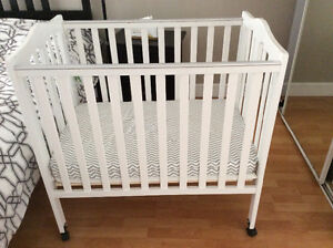 Dream on me 2 in 1 crib  with mattress and mattress pad.